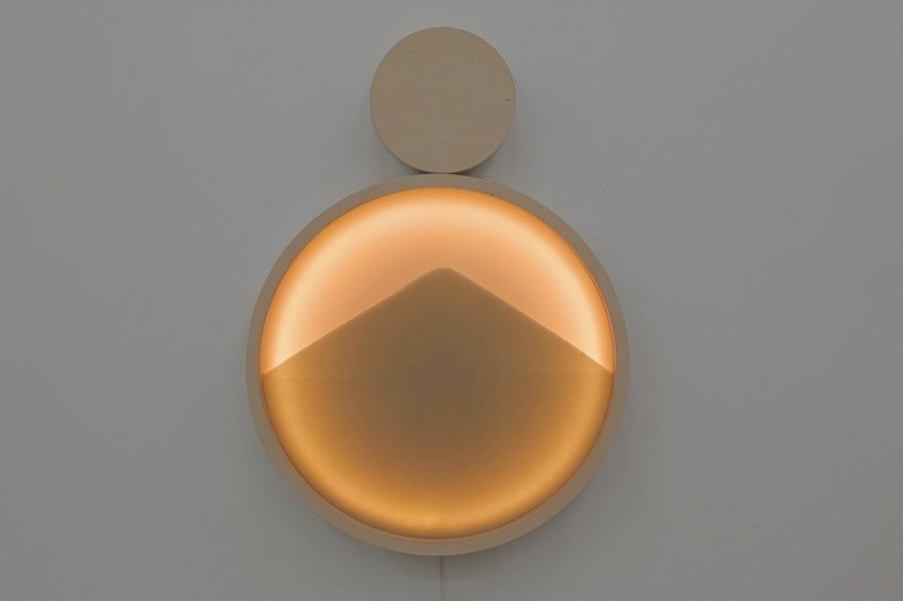 'kolo' kinetic light by pani jurek + piotr musialowski filled with sand