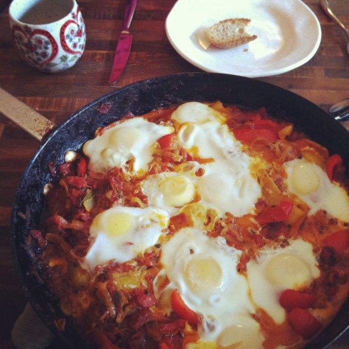 Shakshuka is my new favorite breakfast - a tomato/pepper stew with eggs poached in it, best served with crusty bread.