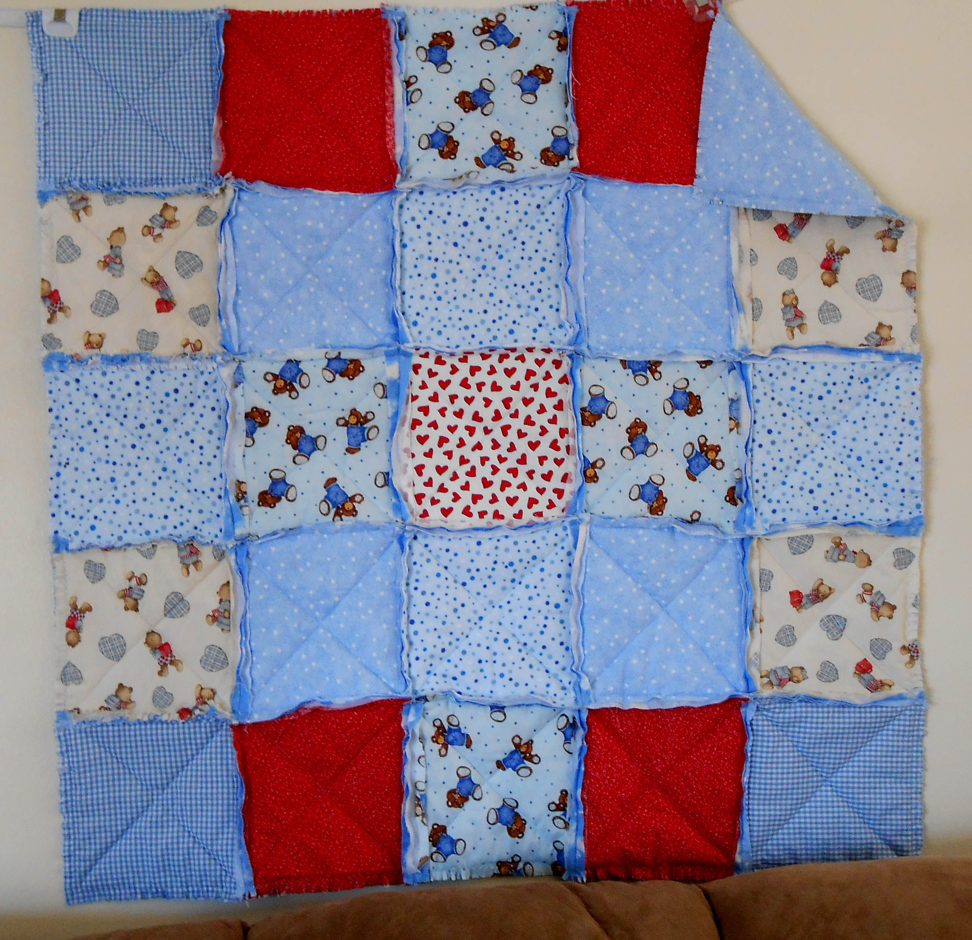 05-03-13  Rag quilt.  Messed up my thumb so have not been able to do all the cutting yet.  Soon!!