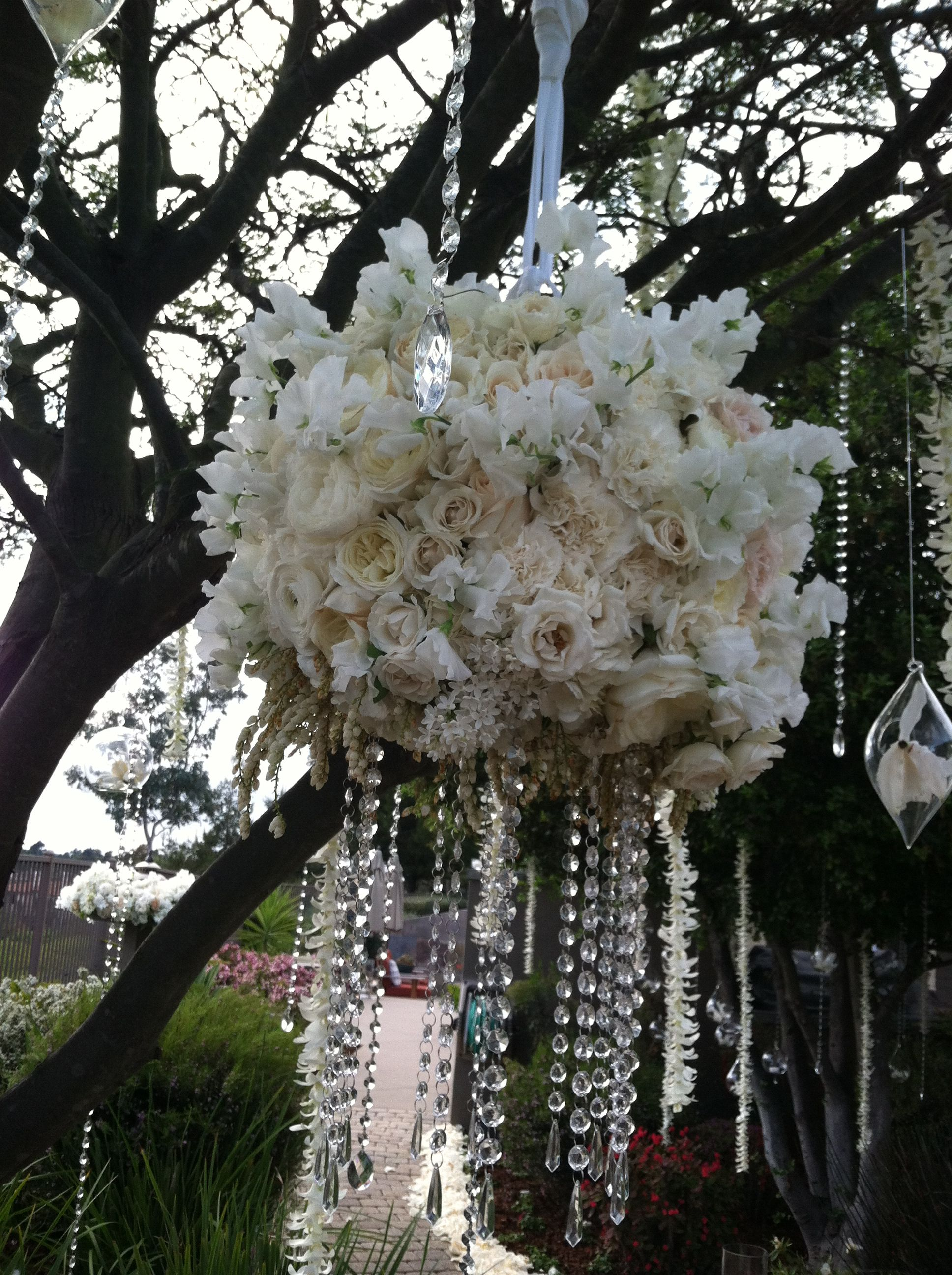 Stunning white flowers hanging in ceremony trees by adorations stunning white flowers hanging in ceremony trees by adorations botanical artistry mightylinksfo