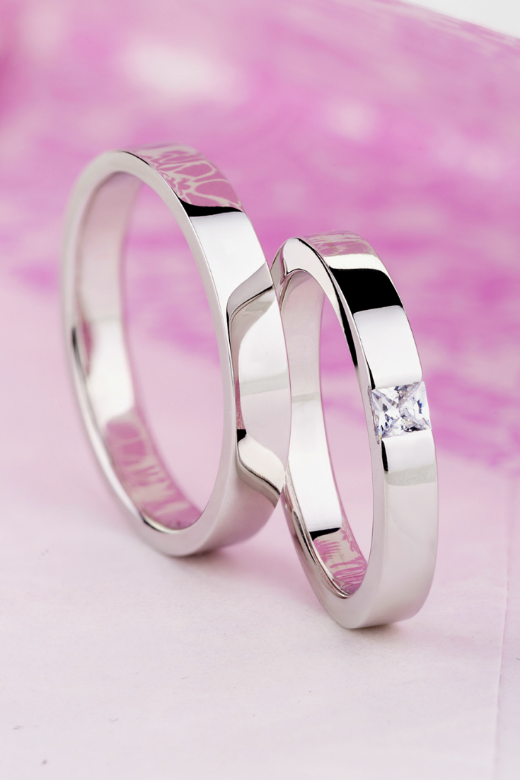 Simple white gold wedding bands with diamond. His and hers