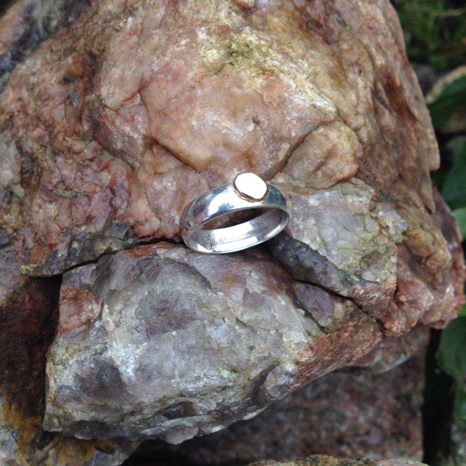 Silver med guldplupp