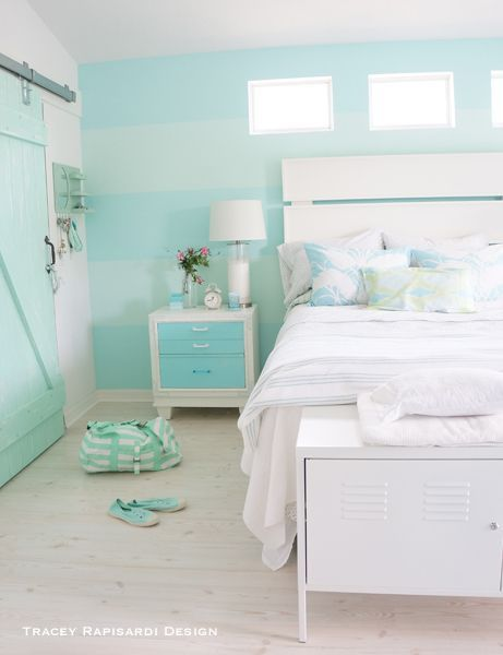 Bright turquoise and white create a bright coastal look. Add hint of patten and paintered wood furniture to complete the look.