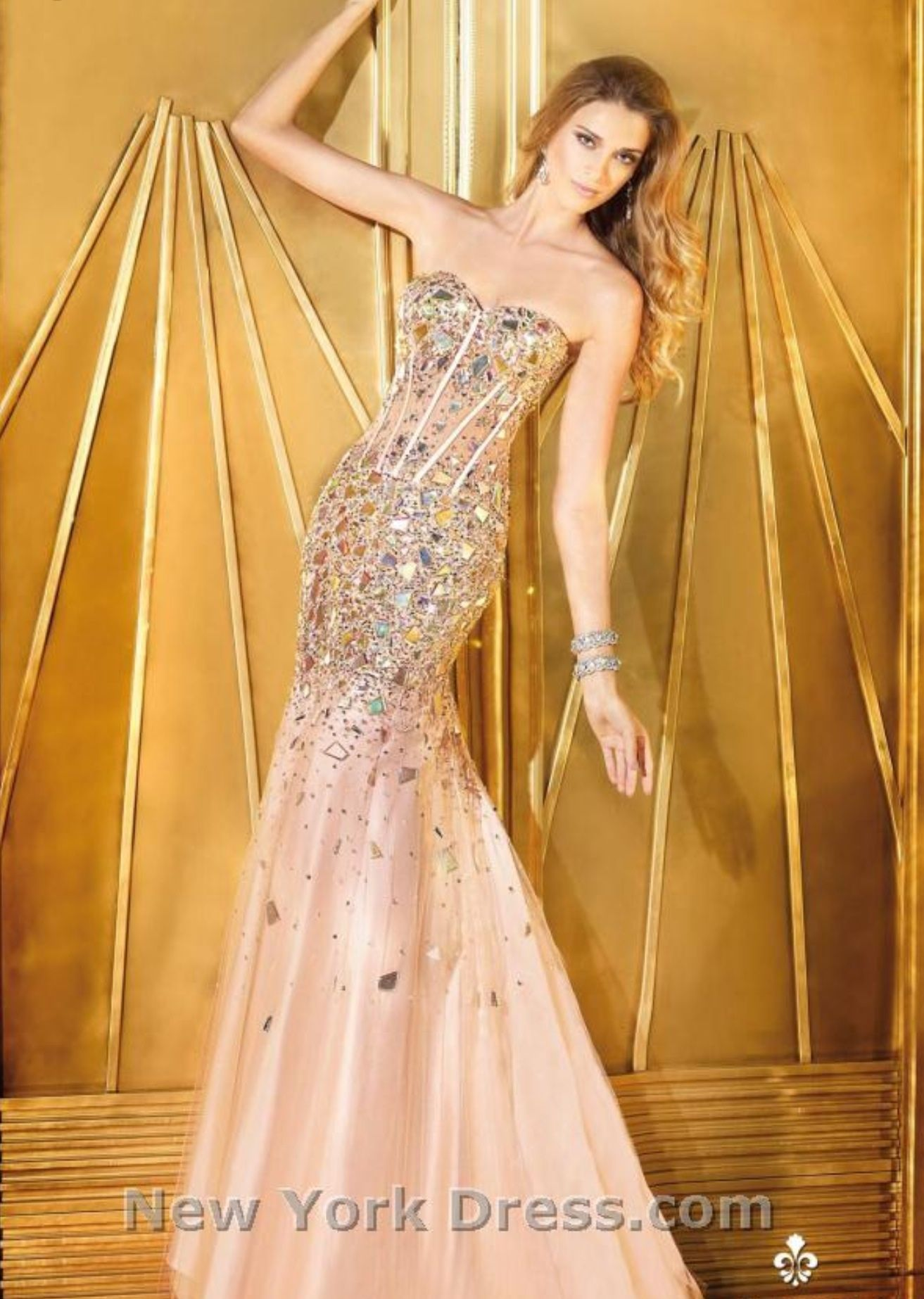 We fell in love with this fish tail dress the sparkles the shape