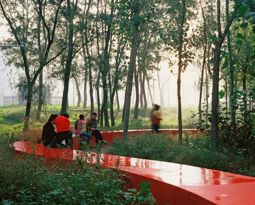 The stunning red ribbon bench of the Tanghe River Park, in Qinhuangdao City, China, by Turenscape, Chinese landscape architecture firm headed by Dr. Kongjian Yu
