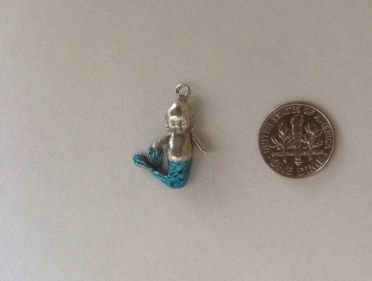 Kewpie sterling silver mer-kewp character turquoise enameled mermaid bracelet charm baby doll pendant Rose O'Neill by TheVintEdge on Etsy https://www.etsy.com/listing/536088175/kewpie-sterling-silver-mer-kewp