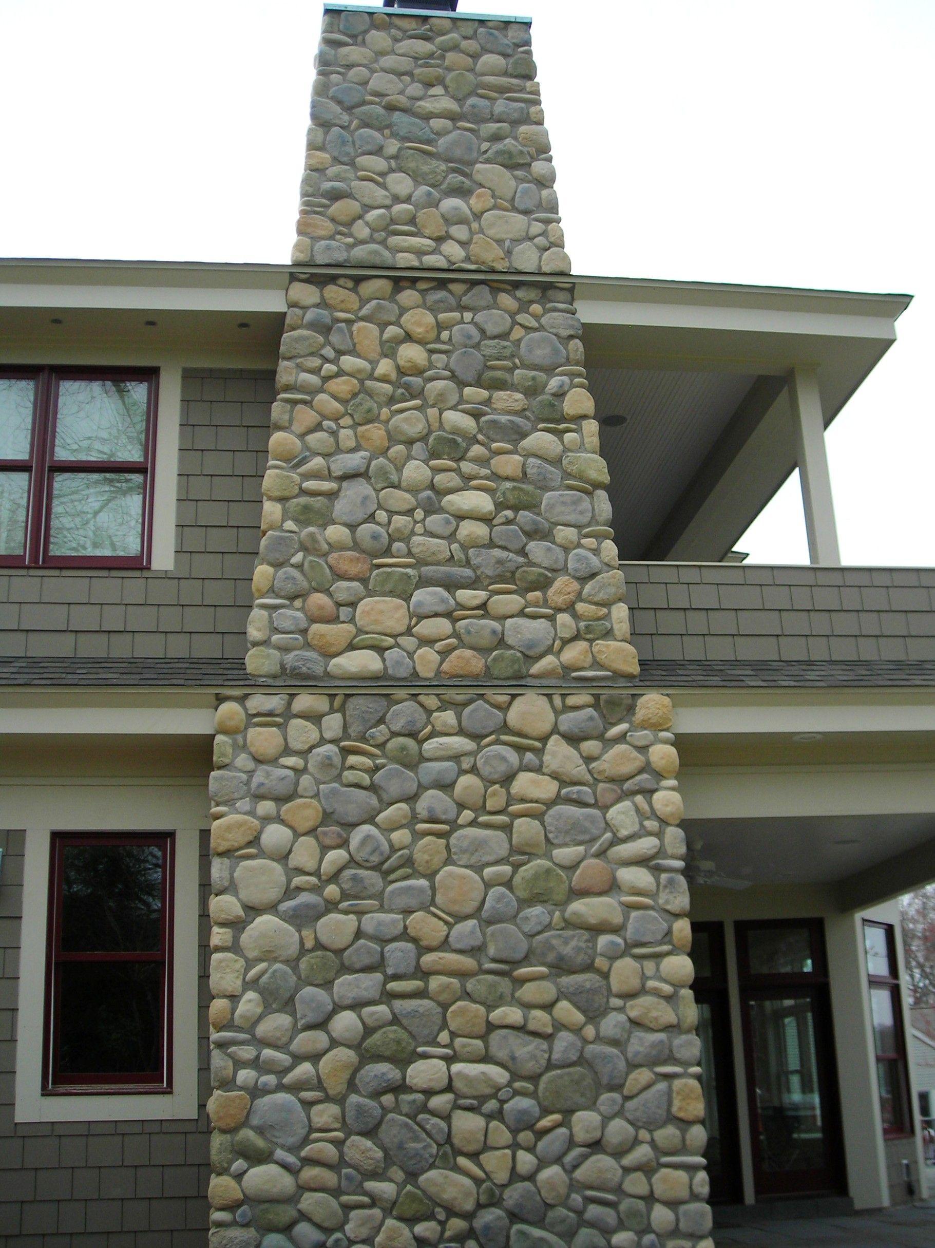 Exterior chimney winter fieldstone w stream stones j n for Stone chimneys