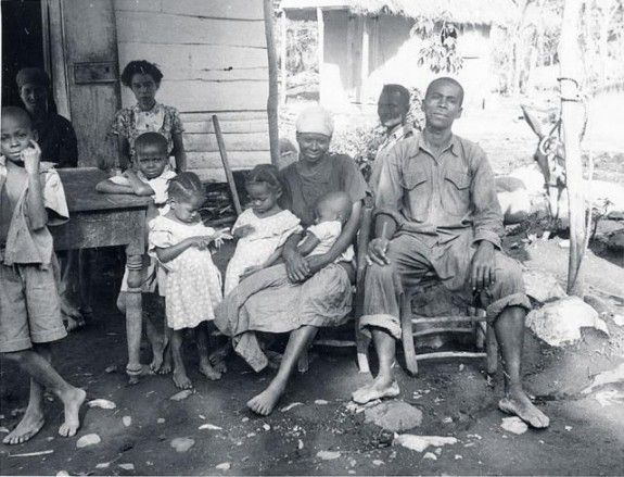 "haiti history 1940s museum quai branly A Haitian extended family gathers for a group photo. Visiting anthropologists like Mercer Cook and Haiti's very own Jean Price Mars noted that in the countryside, Haitian families kept the living traditions of their ancestors in Africa, including the ""lakou"" system, in which various families lived in one unit. Even today, when some of our parents say 'fanmi', they don't just mean mom, dad, kids, they mean practically the whole family tree!"