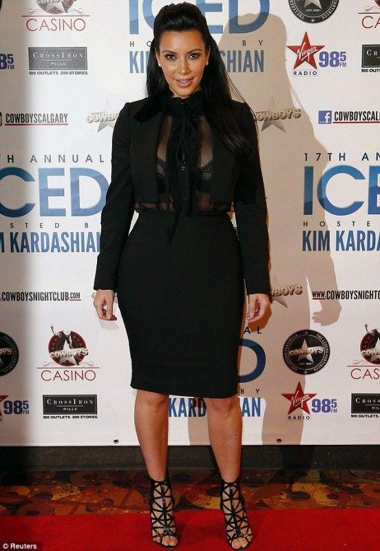 Kim Kardashian wearing Givenchy Bird Cage Ankle Booties Dolce & Gabbana Ruffle Shirt Dolce & Gabbana Black Viscose skirt