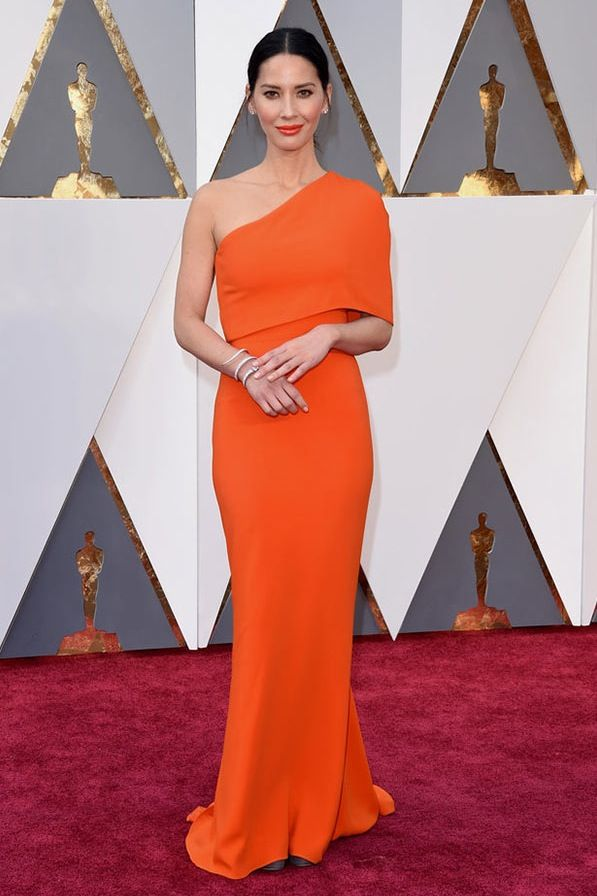OSCARS 2016 OLIVIA MUNN IN STELLA MCCARTNEY - There's always one starkly modern gown in the mix. This year, the X-Men: Apocalypse star filled that role with a cheery little half cape.