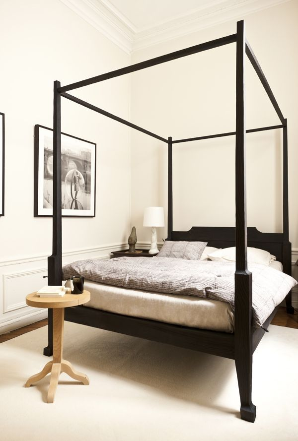 Modern canopy bed in a traditional interior.
