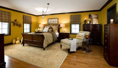 A Masterful Bedroom Muted Yellow Walls Chocolate Trim And