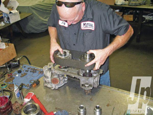 Quadra Trac Rebuild Man Assembling Transfer Case Photo 35648185
