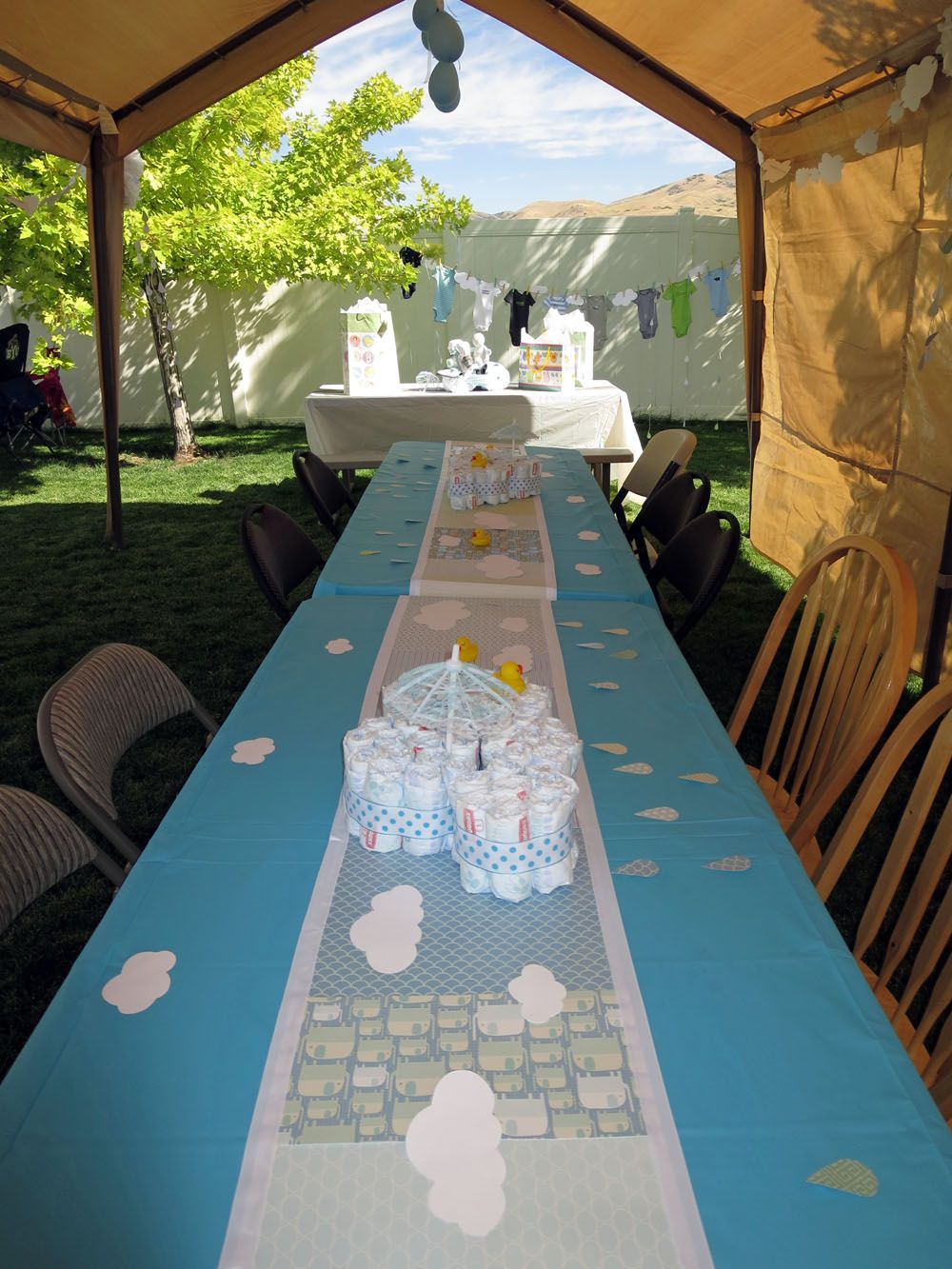 Rainy day boy baby shower outdoor tent set up Baby Shower