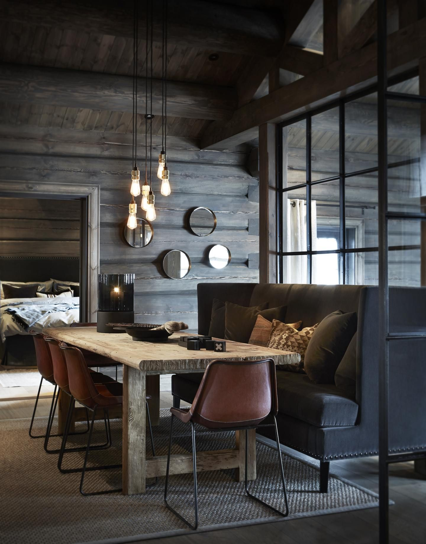 Dark wood exposed rafters glamourous lighting and mid century