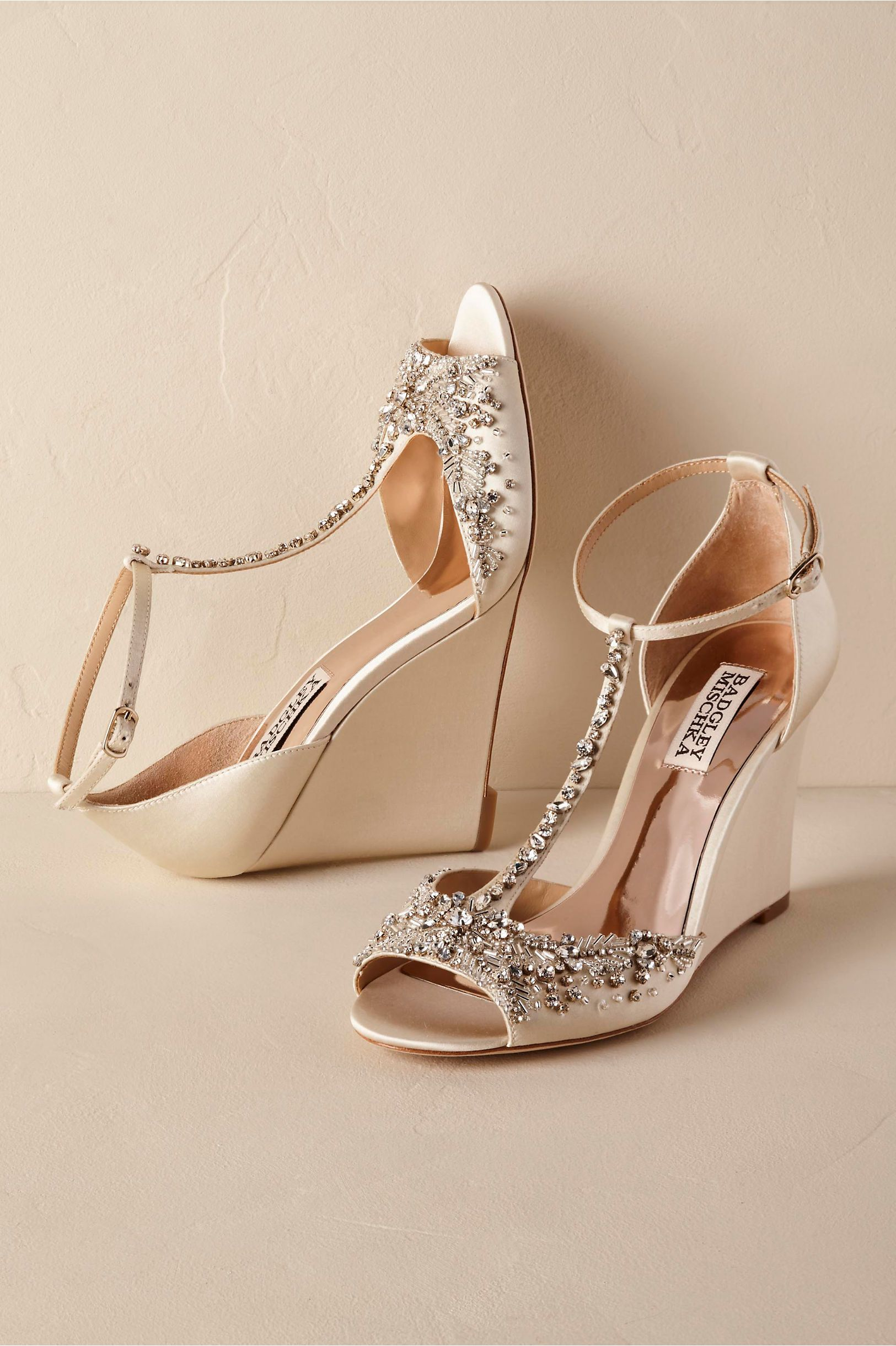 7630dc699 ... wedding shoes and more! BHLDN s Badgley Mischka Chiara Wedges in Ivory