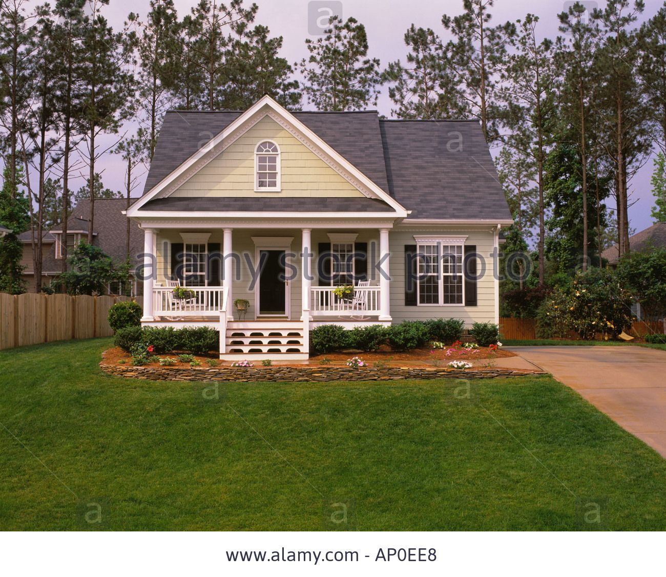Stock Photo Small Tan House With Black Shutters White Trim And A