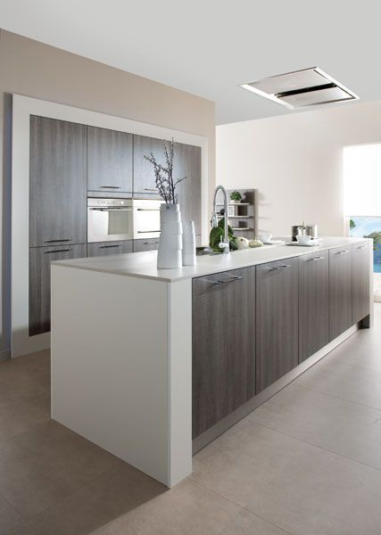 Arcos modern kitchen with textured fronts chrome handles