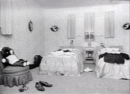 Elvis' bedroom on Audobon Drive. Isn't this fascinating? This is the bedroom of a 21 year old man? Check out the white bucks on the floor, the guitar against the wall, and the damn angels all over the walls. @Wertheimer