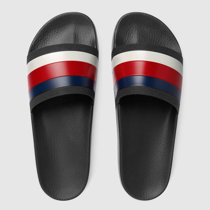 9fd211c21478  210 GUCCI Rubber slide sandal - SOLD by GUCCI - affiliate - The slide  sandal features a Sylvie Web detail across the strap. The blue