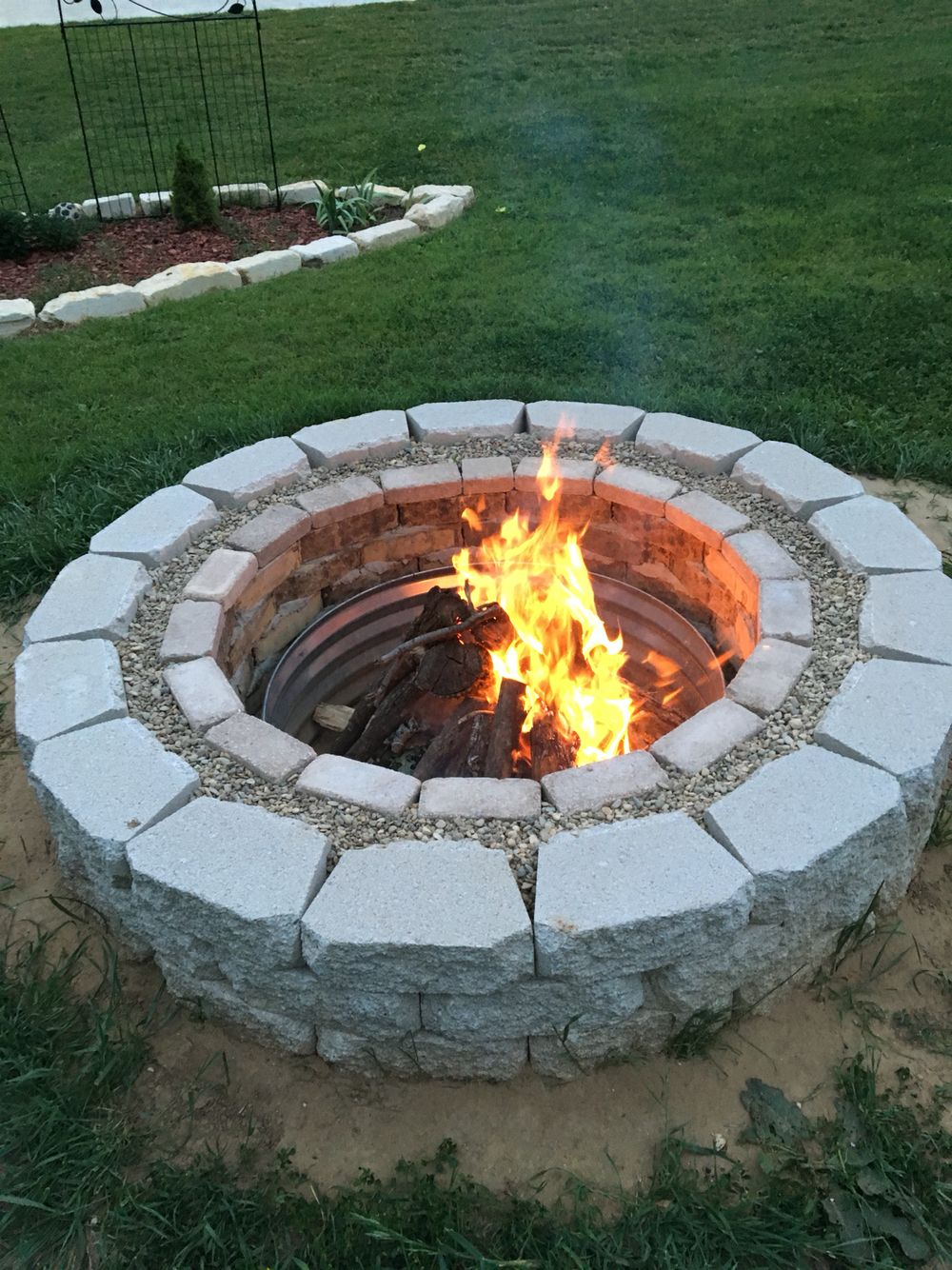 Fire pit made from bricks grout gravel and retaining