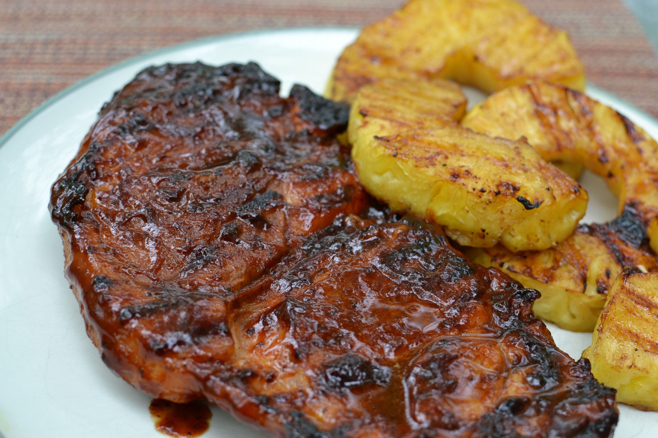 Grilled pork steaks - juicy and full of flavor!  Not your typical overcooked flavors.  Plus the recipe is written in a funny way.... #grilledporksteaks
