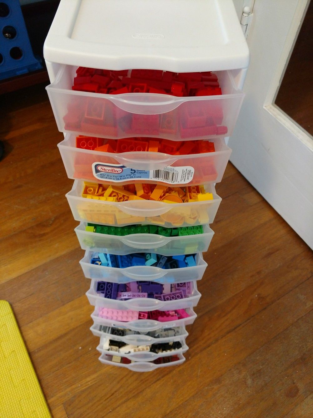 Easy $15 Lego Storage. Two, five drawer Sterilite Storage Containers  stacked together using a hot glue gun. Holds 2,000+ Legos.