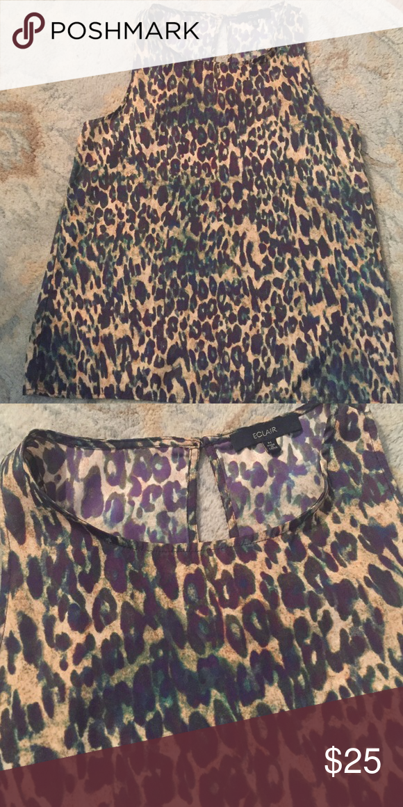 Stitch Fix Top EUC Leopard Print top, by Eclair.  Super cute with skinny jeans, heels and blazer!  The print is gold/tan and navy, makes it unique and super cute with blue jeans or white jeans!  Perfect GNO top. Stitch Fix Tops Blouses