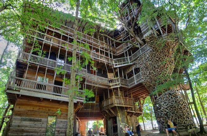 tour the worlds largest treehouse its 97 feet tall and is supported by 6 different