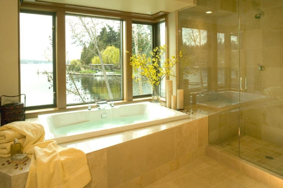 Contemporary bathroom design with luxurious bathtub beside a window ...