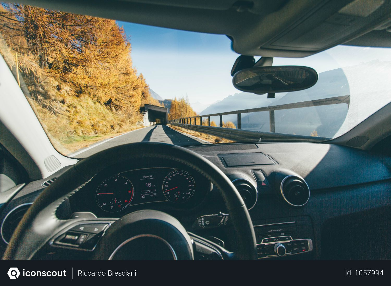 Free Driving Car On Asphalt Road Beside Rocky Mountain