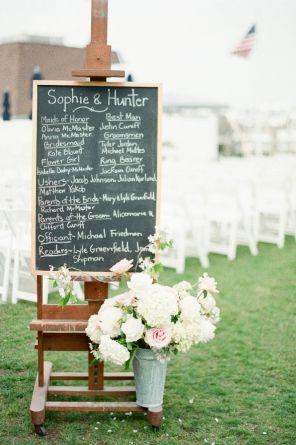 Wedding Ceremony, Montauk Yacht Club, Flowers by: Amagansett Flowers by Beth, Photo: Brklyn View Photography - Montauk Wedding http://caratsandcake.com/sophieandhunter