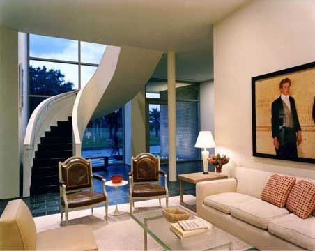 Luxury-living-room-with-spiral-stairs-and-vast-windows