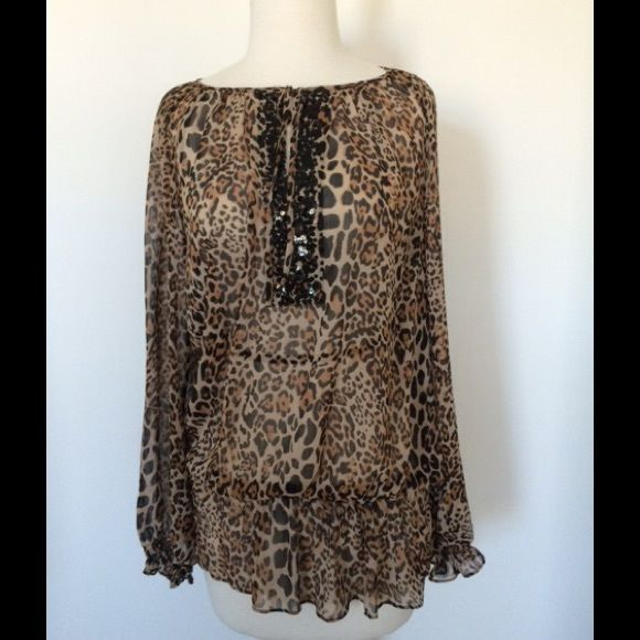 Sunny Leigh Embellished Top Sunny Leigh embellished animal print top.  Black sequin detail at keyhole neckline.  Brand New.  Tag is unattached, but included. Sunny Leigh Tops