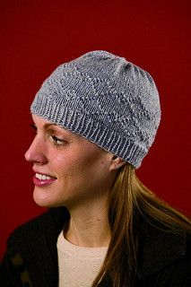 This hat is a simple skull cap-style, meant to fit close to your head. It will fit multiple sizes of heads, since the knitted fabric is stretchy. The diamond pattern is created by strategically placed purled stitches. Sometimes a simple hat with a little bit of texture is all that is needed to be Winter chic.