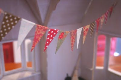tiny bunting in a dollhouse