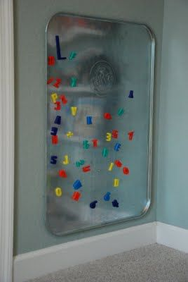 Great idea from the auto parts store...a drip pan becomes a magnetic board for a playroom! Love it!