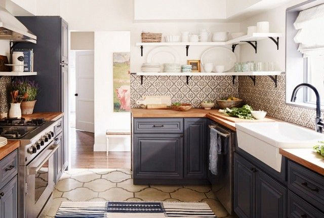 A Densely Patterned, Tiled Backsplash Stands Out In This Stylish, Country  Inspired Space