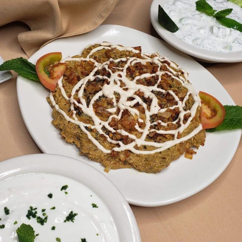 Want something deliciously Persian and Vegetarian!? Try our Kashkeh Bademjan Eggplant appetizer topped with fried  onions, fried garlic and mint oil! Perfect with our fresh oven bread. (Also pictured Maust Khiar yogurt cucumber and maust moosier yogurt and shallots) . . . .
