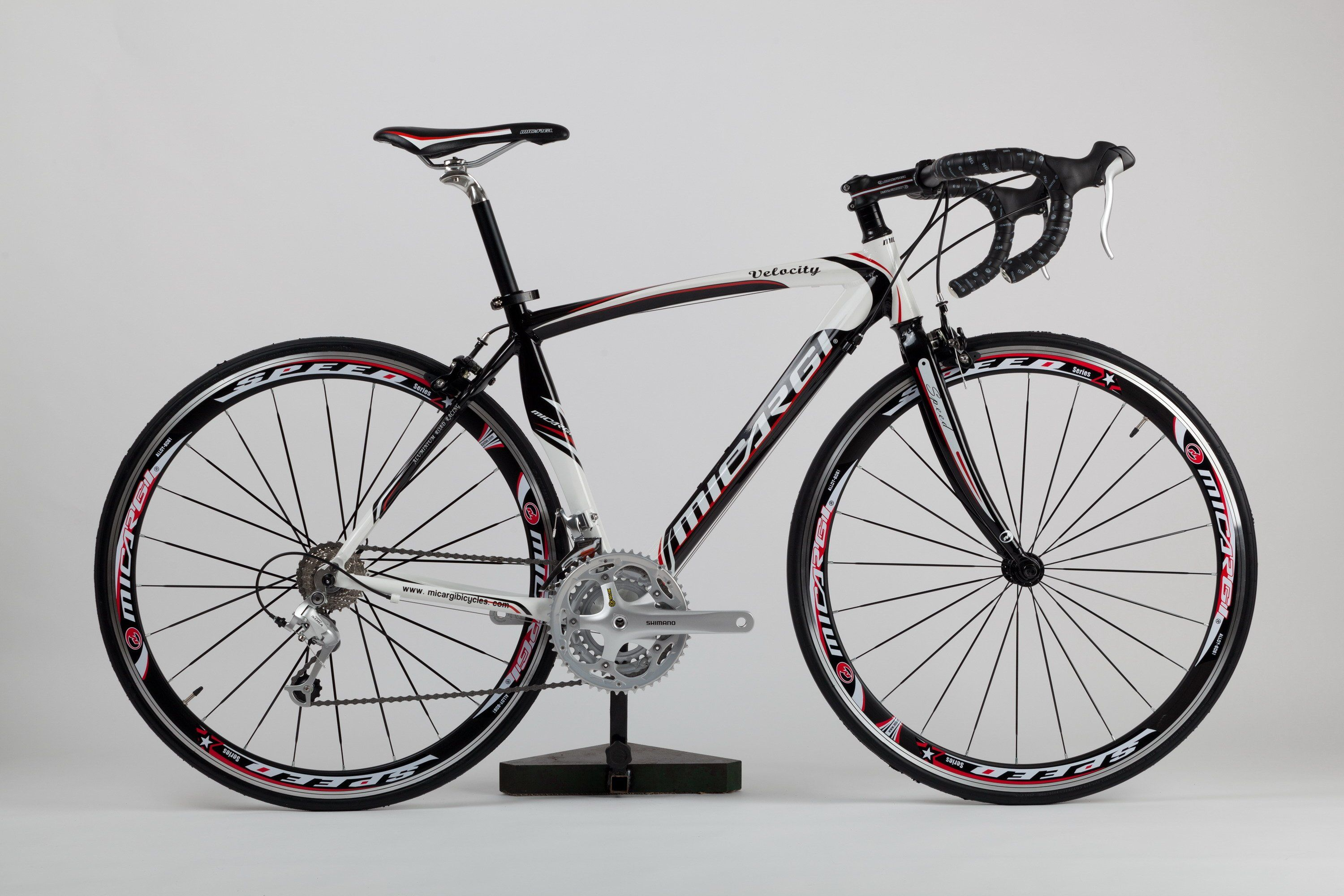 The Micargi Velocity Aluminum Road Bike with Shimano STI Integrated ...