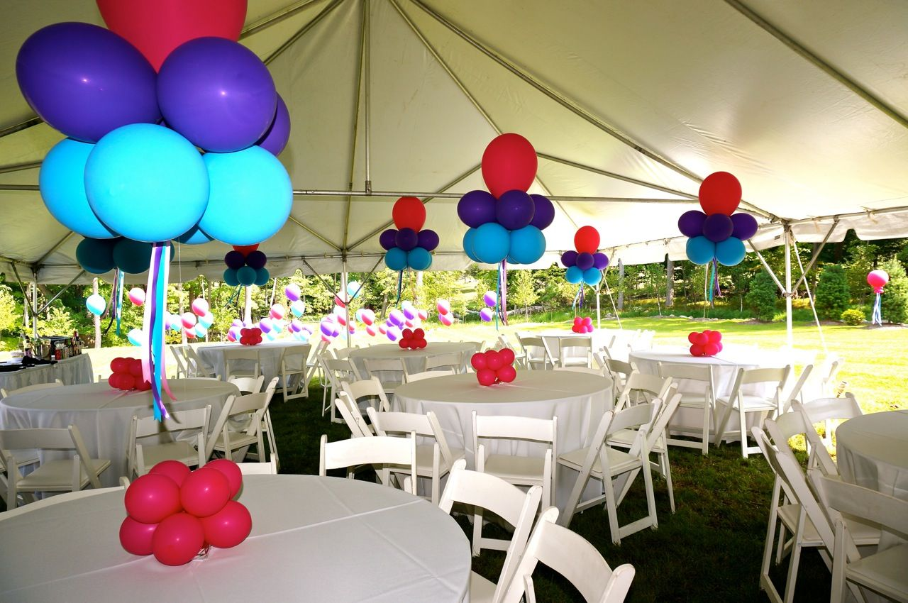 Pink purple and blue balloon centerpieces inside the tent