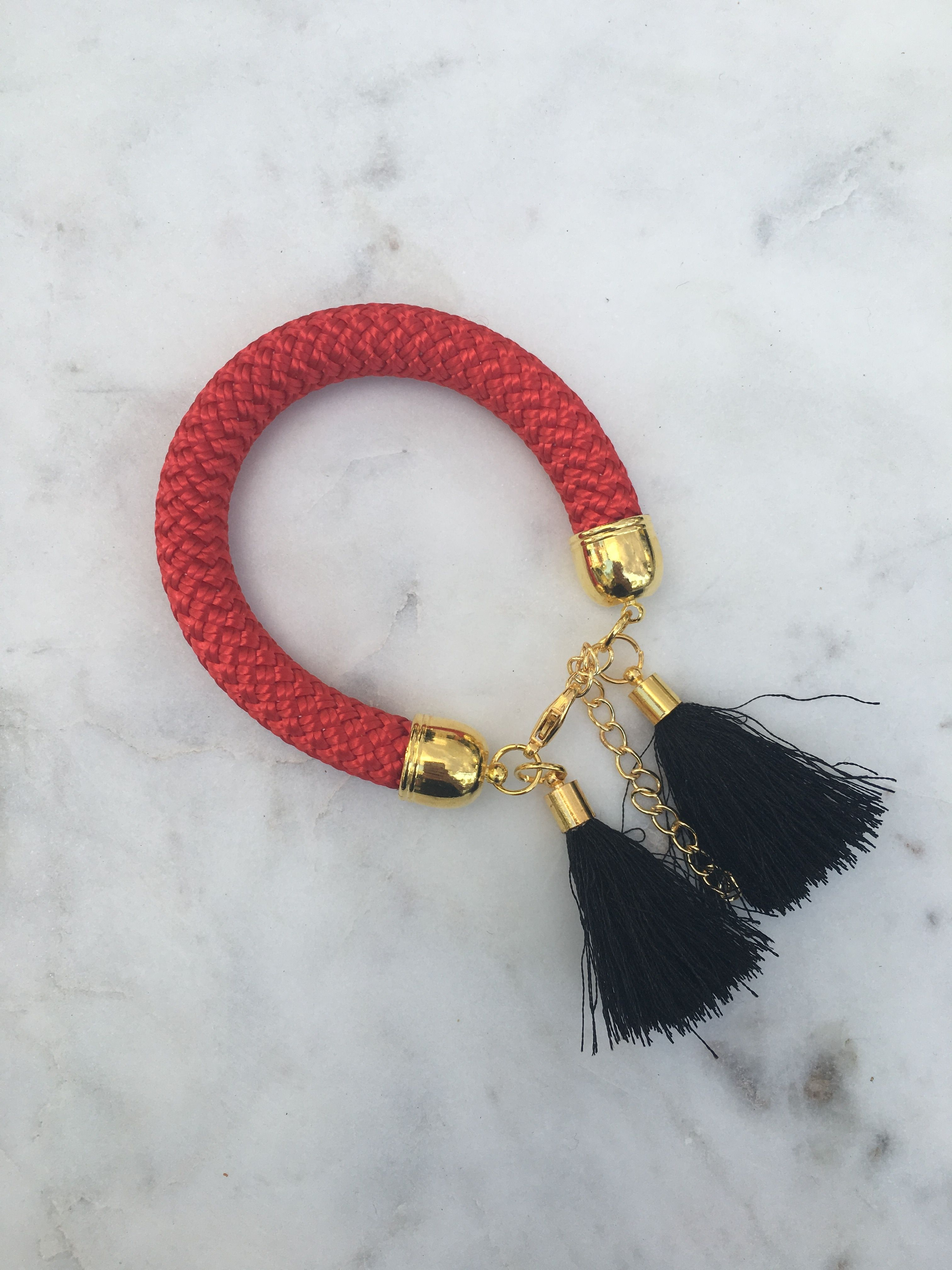 One-of-a-kind tassel bracelets available at Uppermoda