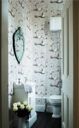 8 Clever Tricks On How To Make A Small Bathroom Look Bigger Small Bathroom Wallpaper Small Bathroom Small Toilet Room