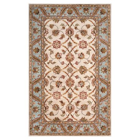 Wool rug with a traditional floral motif. Hand-tufted in India.    Product: RugConstruction Material: Wool