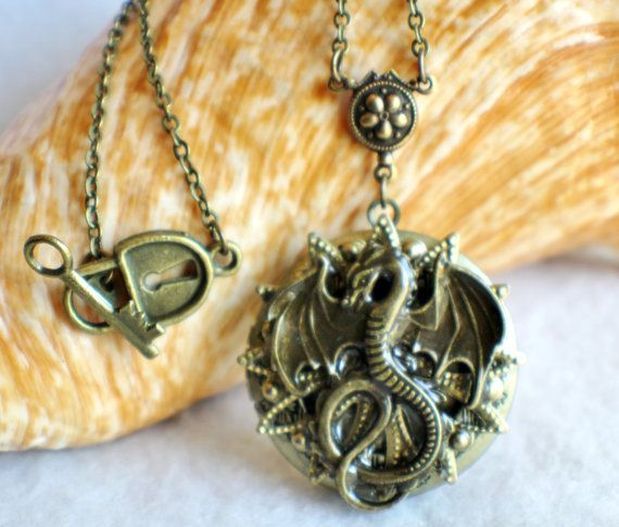 Dragon photo locket round bronze locket by Charsfavoritethings 28$ #dragon #gameofthrones #shopping