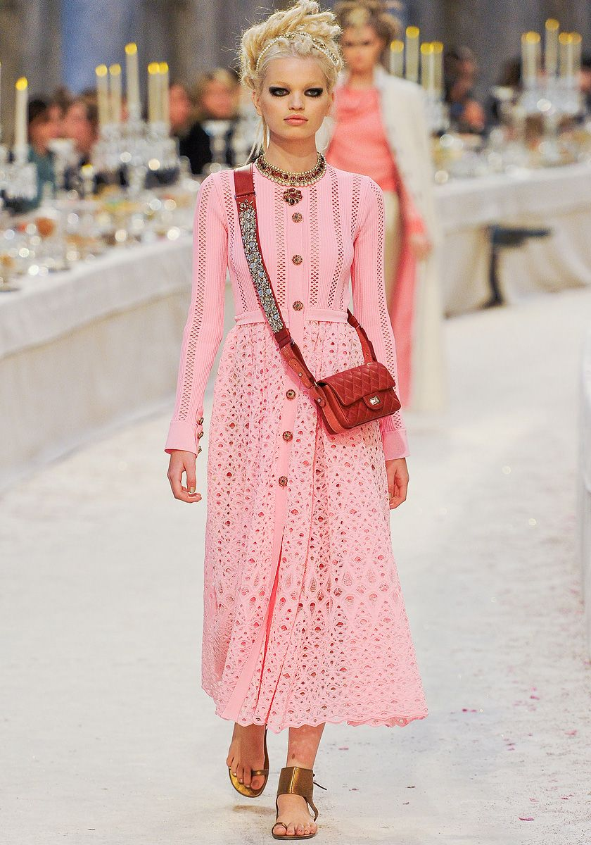 I love the pink dress with the red chanel bag! She looks like barbie ...
