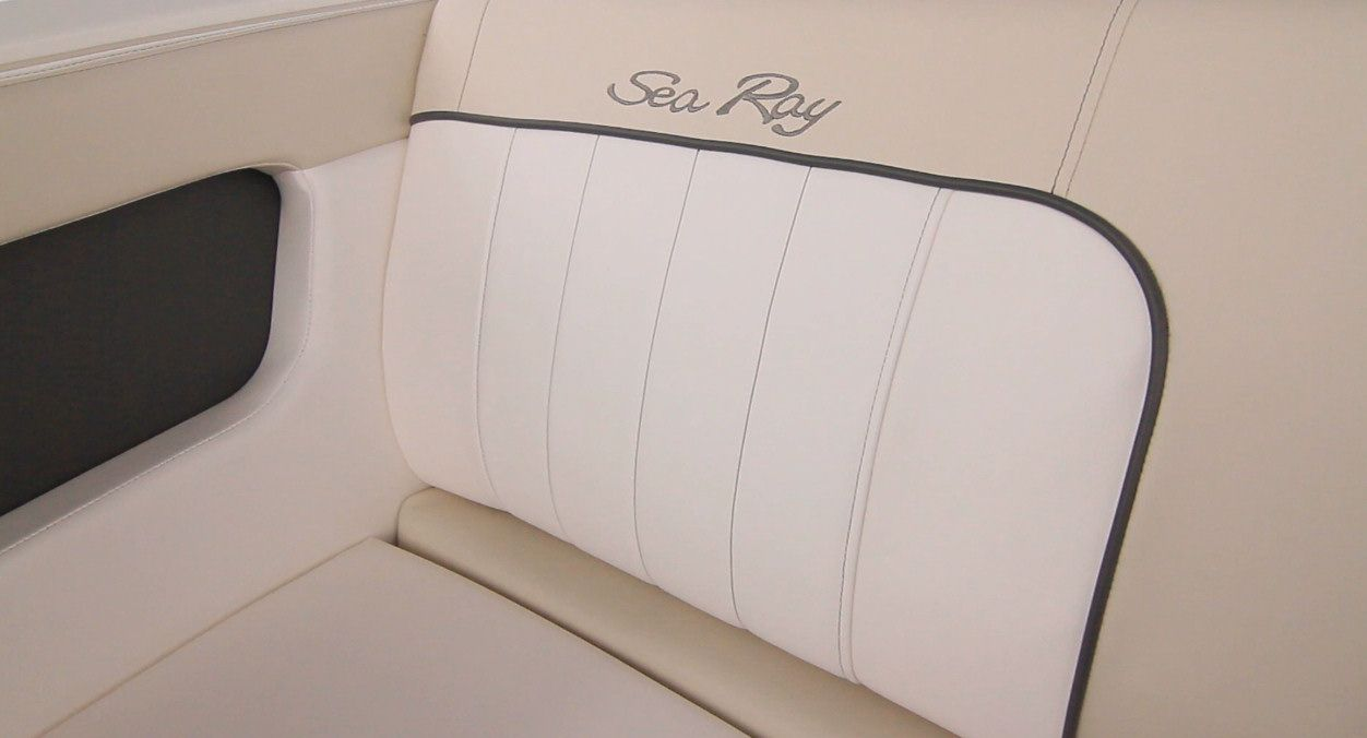 First rate materials, with multiple patterns and tones and even custom embroidery adorn the interior of the Sea Ray 220 Sundeck.