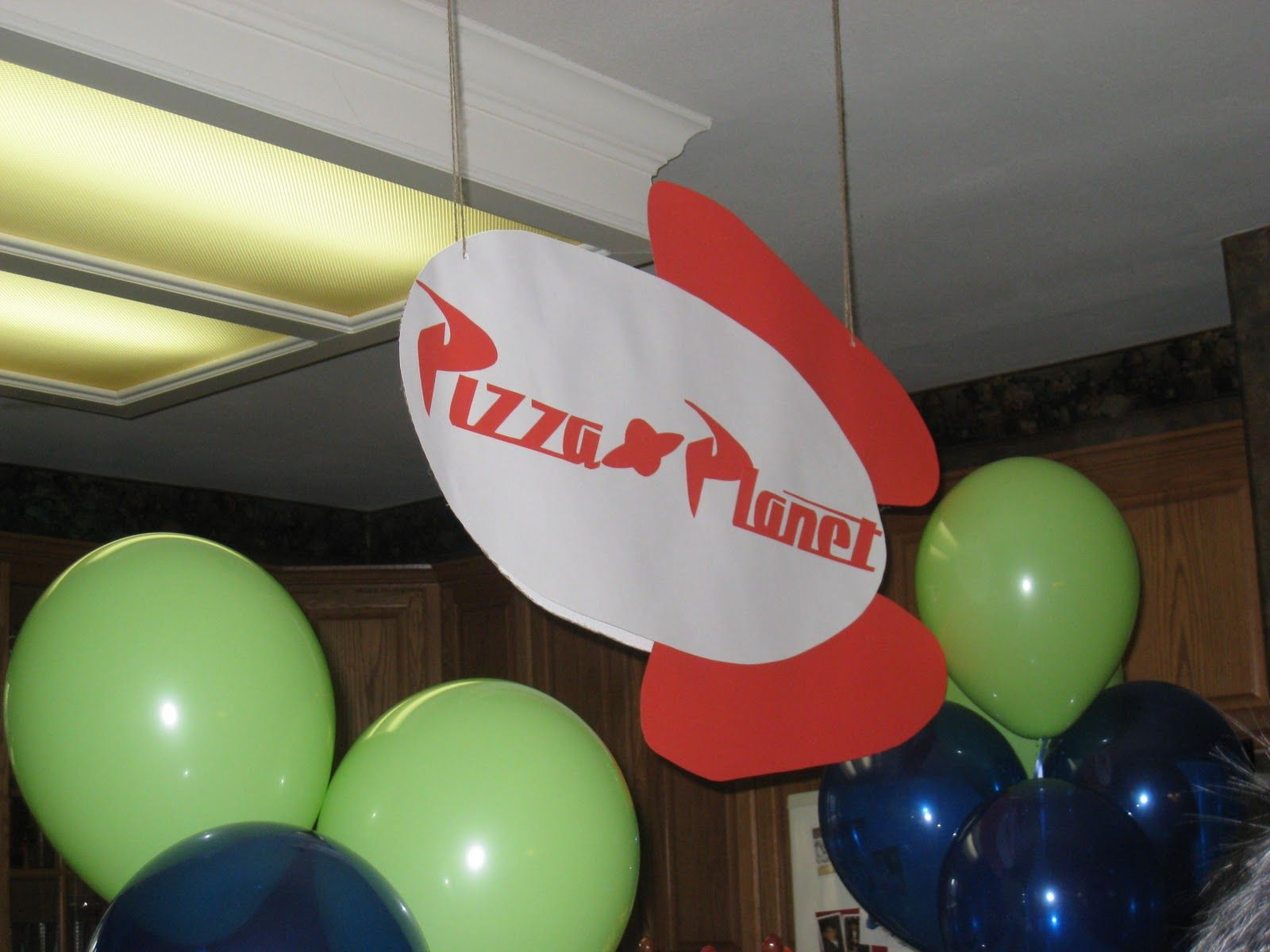 The Party Wall: Toy Story Party Pizza Planet Sign... Would be awesome for a pizza party bday
