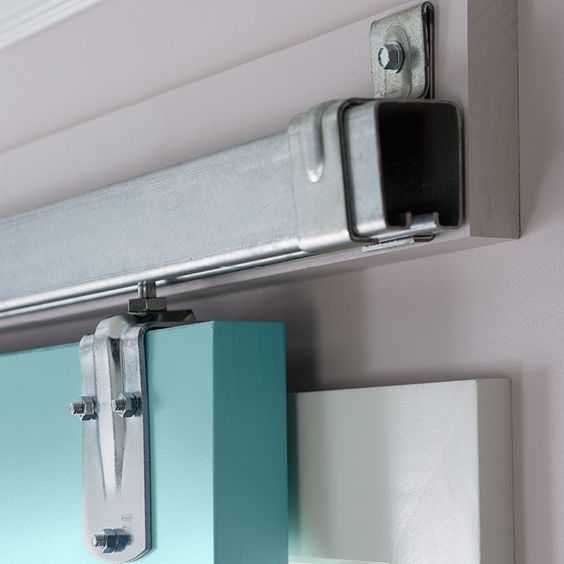 Sliding door hardware on a ledger board. Instead of fastening the barn door rail to drywall first screw a ledger board to the wall studs for a stuu2026 & Sliding door hardware on a ledger board. Instead of fastening the ...