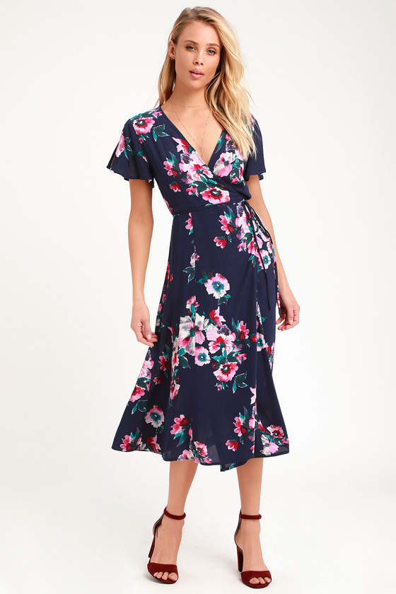 c4ba9976d21 Look like you're walking on a daydream in the Lulus Krizta Navy Blue Floral  Print Midi Wrap Dress! Moody hues of navy blue, pink, magenta, teal, ...
